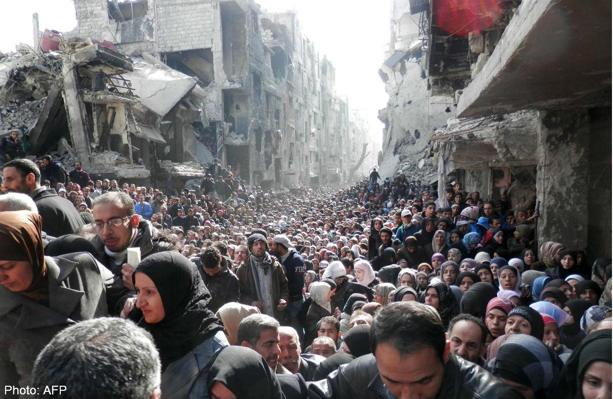 280214_AFP_refugeesyarmuk